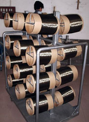 Handling trolley with drums of BCF filament (primary fiber)